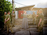 Natalia Voronkova, a volunteer who offers support and basic first aid training for Ukrainian government forces fighting Russian-backed separatists in the east of the country, gathers a group of soldiers from the 24th brigade for a role-play of real life medical situations that may be encountered by soldiers fighting on the frontlines.