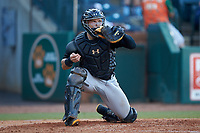 West Virginia Power catcher Deon Stafford (22) warms up his pitcher between innings of the game against the Greensboro Grasshoppers at First National Bank Field on August 9, 2018 in Greensboro, North Carolina. The Power defeated the Grasshoppers 5-3 in game one of a double-header. (Brian Westerholt/Four Seam Images)