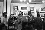 "The Photographers Gallery Great Newport Street London 1976. ""Co Optic""  Christmas Print Auction. L-R Chris Steele-Perkins, Margo Hapgood from Time Life Books. Bryn Campbell, Lewis Ambler who ran Travelling Light's mounting and framing operation, Mark Haworth-Booth."