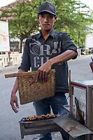 Yogyakarta, Java, Indonesia.  Street Food Vendor Preparing Chicken Kabobs, or Chicken Satay.