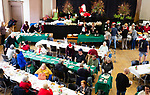 NAUGATUCK,  CT-122519JS06- Guests enjoy their meals during the annual Christmas Day Dinner at St. Michael's Church in Naugatuck on Wednesday. The dinner, which as been a tradition for over 30 years, was started by Naugatuck resident John Ford and his late wife Maureen, to show their children the true meaning of Christmas. The event is now run by Jim and Susan Goggin. <br /> Jim Shannon Republican-American