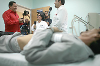 President of Venezuela Hugo Chavez visits a new medical center in Caucagua and speak with patients.