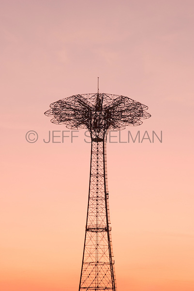 AVAILABLE FROM JEFF AS A FINE ART PRINT.<br /> <br /> AVAILABLE FROM PLAINPICTURE FOR COMMERCIAL AND EDITORIAL LICENSING. Please go to www.plainpicture.com and search for image # p5690046.<br /> <br /> The Parachute Jump at Dusk, Coney Island, Brooklyn, New York, New York<br /> <br /> The (now abandoned) Parachute Jump was built for the 1939 World's Fair in Flushing Meadows Park, Queens, New York City and was moved to Steeplechase Park, Coney Island in 1941.  The Parachute Jump is a New York City Landmark and is listed on the National Register of Historic Places.