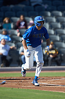 Matt Mervis (20) of the Duke Blue Devils hustles down the first base line against the Coastal Carolina Chanticleers at Segra Stadium on November 2, 2019 in Fayetteville, North Carolina. (Brian Westerholt/Four Seam Images)