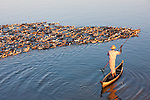 A man and a raft of ducks, Taungthaman Lake, Amarapura, Myanmar