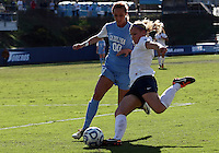 SAN DIEGO, CA - DECEMBER 02, 2012:  Alyssa Rich (00) of the University of North Carolina tries to stop a cross from Emily Hurd (3) of Penn State University during the NCAA 2012 women's college championship match, at Torero Stadium, in San Diego, CA, on Sunday, December 02 2012. Carolina won 4-1.