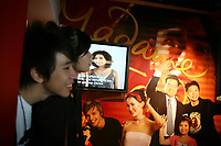 CHINA. Hong Kong. Tourists outside Madame Tussaud's. Officially the Hong Kong Special Administrative Region, it is a territory located on China's south coast on the Pearl River Delta. It has a population of 6.9 million people, and is one of the most densely populated areas in the world. 2008