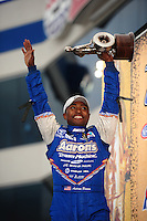 Sept. 18, 2011; Concord, NC, USA: NHRA top fuel dragster driver Antron Brown celebrates after winning the O'Reilly Auto Parts Nationals at zMax Dragway. Mandatory Credit: Mark J. Rebilas-