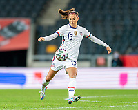 SOLNA, SWEDEN - APRIL 10: Alex Morgan #13 of the USWNT passes the ball during a game between Sweden and USWNT at Friends Arena on April 10, 2021 in Solna, Sweden.