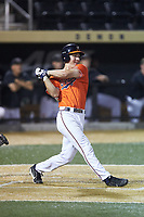 Jake McCarthy (31) of the Virginia Cavaliers follows through on his swing against the Wake Forest Demon Deacons at David F. Couch Ballpark on May 18, 2018 in  Winston-Salem, North Carolina.  The Cavaliers defeated the Demon Deacons 15-3.  (Brian Westerholt/Four Seam Images)