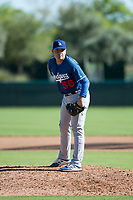 Los Angeles Dodgers relief pitcher Jose Rodulfo (56) looks in for the sign during an Instructional League game against the San Diego Padres at Camelback Ranch on September 25, 2018 in Glendale, Arizona. (Zachary Lucy/Four Seam Images)