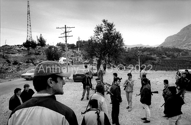 Kruje, Albania<br /> February 1997<br /> <br /> At the entrance to the northern city of Kruje, dozens of heavily armed men appear at a check point. They claim to be working with the police but it is unclear if they are police or bandits.