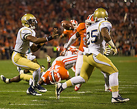 The eighth ranked Clemson Tigers defeat the Georgia Tech Yellow Jackets at Death Valley 55-31 in an ACC matchup.  Georgia Tech Yellow Jackets quarterback Vad Lee (2) pitches the ball to Georgia Tech Yellow Jackets running back Robert Godhigh (25)