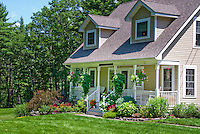 House and lawn landscaping, blue sky and clouds on a summer sunny day, curb appeal