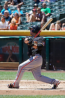 Mark Minicozzi (23) of the Fresno Grizzlies at bat against the Salt Lake Bees at Smith's Ballpark on May 26, 2014 in Salt Lake City, Utah.  (Stephen Smith/Four Seam Images)