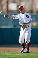 Garrett Buechele (38) throws to first while warming up between innings during the NCAA matchup between the University of Arkansas-Little Rock Trojans and the University of Oklahoma Sooners at L. Dale Mitchell Park in Norman, Oklahoma; March 11th, 2011.  Oklahoma won 11-3.  Photo by William Purnell/Four Seam Images