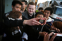 CHINA. Beijing. Snooker player Shaun Murphy is swarmed by fans aoutside the China Snooker Open. Snooker is a cue sport played on a large table measuring 3.6 metres x 1.8 metres. Originating in India in the late 19th Century where it was invented by British Army officers, the game has been a mainstay in British sport over the past few decades. Recently however, popularity of the sport has declined as the sport struggles to compete with other popular sports. The sport is however flourishing in countries such as China, where it is now the second most popular sport, behind Basketball. In a country where the  players are treated like movie-stars, China may be the great hope for the sports recovery. 2009