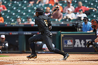 Alonzo Jones (8) of the Vanderbilt Commodores follows through on his swing against the Sam Houston State Bearkats in game one of the 2018 Shriners Hospitals for Children College Classic at Minute Maid Park on March 2, 2018 in Houston, Texas. The Bearkats walked-off the Commodores 7-6 in 10 innings.   (Brian Westerholt/Four Seam Images)