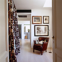 Framed black and white period photographs decorate one wall of the master bedroom