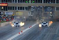 Jul, 20, 2012; Morrison, CO, USA: NHRA funny car driver Tony Pedregon (left) alongside Matt Hagan during qualifying for the Mile High Nationals at Bandimere Speedway. Mandatory Credit: Mark J. Rebilas-