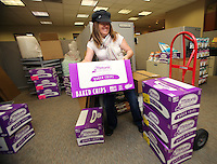 Dec. 8, 2015. Carlsbad,  CA. USA Shipping and receiving Specialist with Milton's Baking, Annette Graham moves products to be shipped at their headquarters in Carlsbad.  Photos by Jamie Scott Lytle. Copyright.