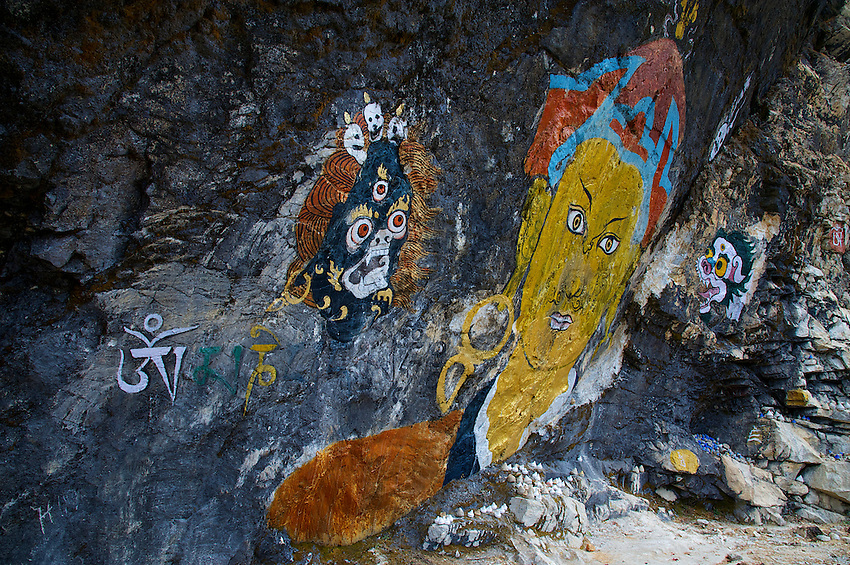 """Trongsa to Thimphu,Bhutan..Also along the road paintings of Buddha on Cliff face. (Chendepii) Paintings of Buddha & Guru Rinpoche from the Buddhist movie """"travelewrs & Magicians"""" produced by Dzongsar Jamyang Khentse Rinpoche Nove. 2002"""