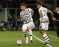 Calcio, Serie A: Fiorentina vs Juventus. Firenze, stadio Artemio Franchi, 24 aprile 2016.<br /> Juventus' Mario Mandzukic, left, in action past his teammate Paulo Dybala during the Italian Serie A football match between Fiorentina and Juventus at Florence's Artemio Franchi stadium, 24 April 2016. <br /> UPDATE IMAGES PRESS/Isabella Bonotto