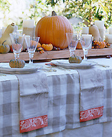 Gourds have been used as place settings on this autumn themed table