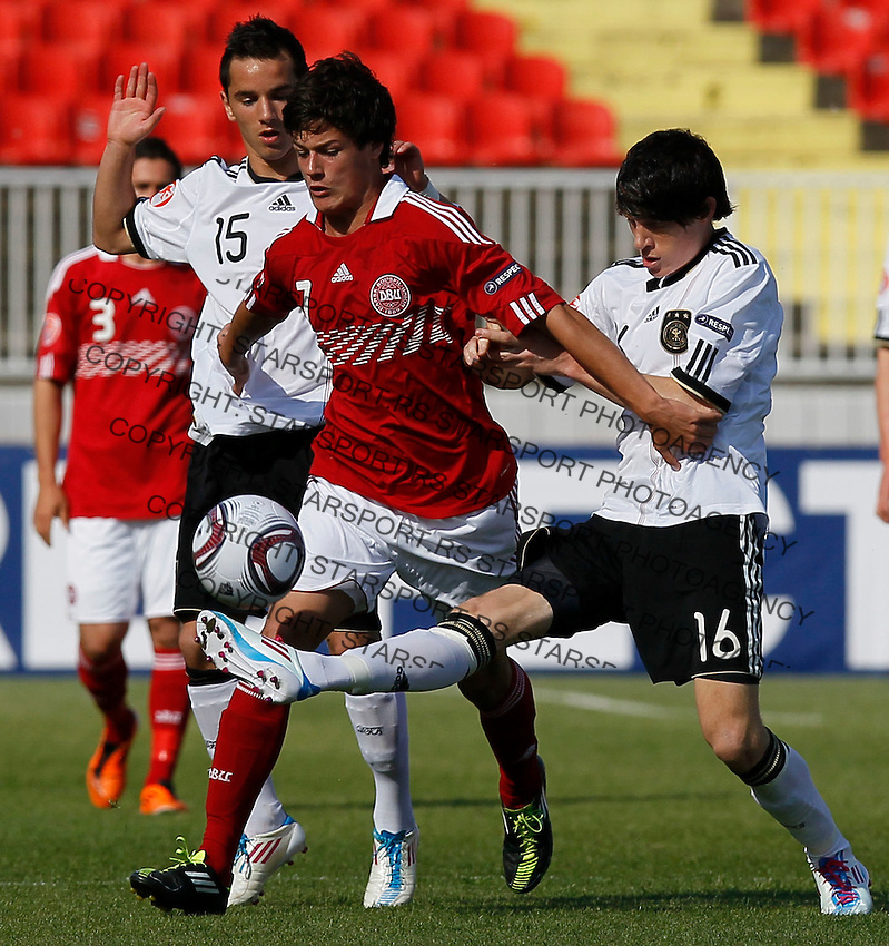 Christian Norgaard (L) of Denmark is challenged by Sven Mende of Germany during the UEFA U17 Championships Semi Final match between Denmark and Germany on May 12, 2011 in Novi Sad, Serbia. (Photo by Srdjan Stevanovic/Starsportphoto.com)