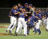 The AZL Rangers celebrate after defeating the Indians Blue team, 7-2, to capture the 2019 Arizona League championship with two straight wins. Game two was played at the Rangers complex in Surprise, Arizona on August 30, 2019 (Bill Mitchell)