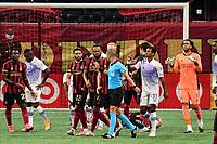 ATLANTA, GA - AUGUST 29: Referee Nima Saghafi waves off complaints from the Atlanta United team during a game between Orlando City SC and Atlanta United FC at Marecedes-Benz Stadium on August 29, 2020 in Atlanta, Georgia.