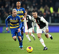 Calcio, Serie A: Juventus - Parma, Turin, Allianz Stadium, January 19, 2020.<br /> Juventus' Cristiano Ronaldo (r) in action with Parma's Simone Iacoponi (l) during the Italian Serie A football match between Juventus and Parma at the Allianz stadium in Turin, January 19, 2020.<br /> UPDATE IMAGES PRESS/Isabella Bonotto