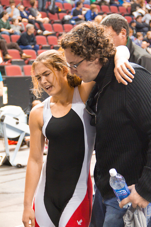 Concept2 Crash-B World Indoor Rowing Championships, 2012, Gabriela Martinez, Miami Beach Watersports Center, leans on coach after race, Lightweight Junior Women, athletes compete annually on a Concept2 Indoor Rower for time over 2000 meters, Agganis Arena, Boston University, Boston, Massachusetts,