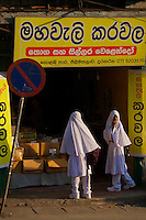Muslim school girls  and Street scene village near Kandy