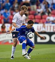 Chad Marshall of the USA defends against Rodolfo Zelaya of El Salvador during a World Cup Qualifying match at Rio Tinto Stadium, in Sandy, Utah, Friday, September 5, 2009.  .The USA won 2-1..