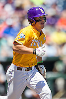 LSU Tigers shortstop Alex Bregman (8) runs to first base during the NCAA College baseball World Series against the Cal State Fullerton on June 16, 2015 at TD Ameritrade Park in Omaha, Nebraska. LSU defeated Fullerton 5-3. (Andrew Woolley/Four Seam Images)