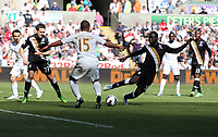 Pictured: Wayne Routledge of Swansea (C) against Sascha Rietner (L) and Emmanuel Frimpong (R) of Fulham. Sunday 19 May 2013<br /> Re: Barclay's Premier League, Swansea City FC v Fulham at the Liberty Stadium, south Wales.
