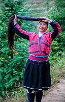 Longji, China.  Woman of Yao Ethnic Minority Showing her Long Hair.