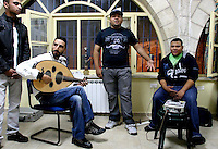 """Rappers """"City Ghosts"""", the twins Mustafa (1st R) and Ali (2nd R) Jabr, perform especiallly for the event with a group of traditional singers and oud-player . during """"Al Quds Underground""""-festival. Palestinian musicians, actors and artists from Jerusalem showcased their work inside private homes, mainly in the Islamic Qurater within the Old City walls. .Photo by Quique Kierszenbaum.."""