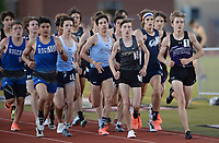 Hudson Betts (right) of Fayetteville leads the field Friday, April 30, 2021, in the 3,200 meters during the 6A-West Conference Track and Field Meet at the Tiger Athletic Complex in Bentonville. Visit nwaonline.com/210501Daily/ for today's photo gallery. <br /> (NWA Democrat-Gazette/Andy Shupe)