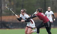 Newton, Massachusetts - April 7, 2015: NCAA Division I lacrosse. Boston College (white) defeated Harvard University (crimson), 19-13, on Newton Campus Field at Boston College.