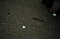 A sticker with the Olympic rings lays on the ground during the Nanjing, China, leg of the 2008 Olympic Torch Relay.  .