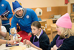 St Johnstone players took some festive cheer to Fairview School in Perth gving out selection boxes and gifts to the pupils…David Wotherspoon hands over a saints teddy bear to secondary school pupil Emily<br />
