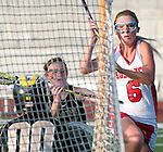 Yorba Linda's Ashlynn Braithwaite readies a shot on Foothills goalie, Emily Kift.<br /> ///ADDITIONAL INFORMATION:<br /> 4/23/13, MARK CHODZKO, FOR THE REGISTER<br /> Foothill @ Yorba Linda Girls Lacrosse