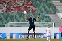 ST. GALLEN, SWITZERLAND - MAY 30: John Brooks #6 of the United States heads a ball during a game between Switzerland and USMNT at Kybunpark on May 30, 2021 in St. Gallen, Switzerland.