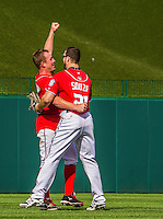 28 September 2014: Washington Nationals starting pitcher Jordan Zimmermann gets a hug from teammate Steven Souza after throwing his first career no-hitter against the Miami Marlins at Nationals Park in Washington, DC. The Nationals shut out the Marlins 1-0, caping the season with the first Nationals no-hitter in modern times. The win also notched a 96 win season for the Nats: the best record in the National League. Mandatory Credit: Ed Wolfstein Photo *** RAW (NEF) Image File Available ***