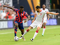 AUSTIN, TX - JULY 29: Khoukhi Boualem #16 of Qatar attempts to steal the ball from Daryl Dike #11 of the United States during a game between Qatar and USMNT at Q2 Stadium on July 29, 2021 in Austin, Texas.