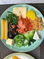 Nanjing, Jiangsu, China.  Breakfast Plate:  cheese, smoked salmon, seaweed, mushrooms, bitter melon, japanese radish.