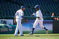 South Bend Cubs manager Jimmy Gonzalez (44) congratulates Eloy Jimenez (27) after hitting a home run during the second game of a doubleheader against the Peoria Chiefs on July 25, 2016 at Four Winds Field in South Bend, Indiana.  South Bend defeated Peoria 9-2.  (Mike Janes/Four Seam Images)