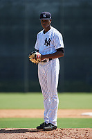 GCL Yankees East starting pitcher Elvis Peguero (61) looks in for the sign during a game against the GCL Blue Jays on August 2, 2018 at Yankee Complex in Tampa, Florida.  GCL Yankees East defeated GCL Blue Jays 5-4.  (Mike Janes/Four Seam Images)